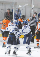 Falcons celebrate Matt Fairchild's goal in overtime to seal the second win over RIT last weekend. Air Force improved to 2-4 overall and 2-0 in the AHA and currently in first place in the league. (Photo by Johnny Wilson)