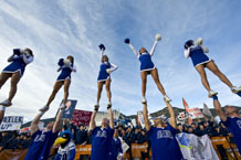 """U.S. Air Force Academy cheerleaders perform on the Terrazzo during ESPN's """"College GameDay"""" broadcast prior to the Air Force vs. Army football game Saturday. Photo by Staff Sgt. Bennie J. Davis III"""