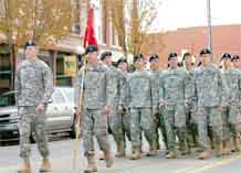 Photo by Spc. Shameka Edwards.  Soldiers of 4th Battalion, 42nd Field Artillery, 1st Brigade Combat Team, 4th Infantry Division, march in formation along Union Street during the 8th Annual Pueblo Chieftain Veterans Day Parade Saturday.