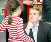 Sen. Michael Bennet shares a moment with first-grader Emma Hamic following the Operation Caring Classroom presentation at Mountainside Elementary School Nov. 13.