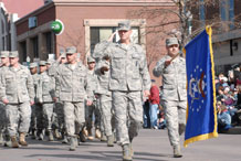 Col. Wayne Monteith, 50th Space Wing commander, leads the men and women of the 50th Space Wing through the streets of downtown Colorado Springs during the 2009 Colorado Springs Veterans Day Parade Nov. 7.