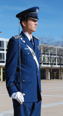 Cadet 1st Class Andrew VanTimmeren stands at attention during the Cadet Wing's noon meal formation Monday. Cadet VanTimmeren succeeded Cadet 1st Class Nathan Dial in a change-of-command ceremony in Mitchell Hall Jan. 5. Photo by Ann Patton