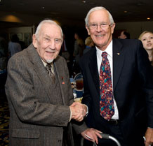 Retired Brig. Gen. Charles Duke, right, poses for a photo with John Eck at the Air Force Academy's National Prayer Luncheon Feb. 9, 2010. General Duke, a former astronaut who walked on the Moon's surface, was the luncheon's guest speaker. Mr. Eck is a survivor of the Dec. 7, 1941 attack on Pearl Harbor. (U.S. Air Force photo/Bill Evans)