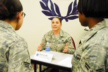 Master Sgt. Cassandra Bushyeager, 50th Force Support Squadron, career assistance advisor, speaks to some Airmen about being a training instructor during a special duty assignment workshop at the First Term Airman Center Feb. 19. (U.S. Air Force photo/Staff Sgt. Daniel Martinez)