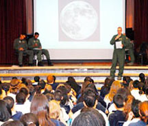 Capt. Tyler Hale tries to persuade the sixth graders at Jack Swigert Aerospace Academy that the United States should fund further exploration of the moon instead of Mars Feb. 18. Four Airmen from the 22nd Space Operations Squadron held the debate at the school to help the schoolchildren understand persuasive speech. (U.S. Air Force photo/Staff Sgt. Daniel Martinez)