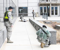 Members of the 50th Security Forces Squadron respond to an exercise scenario involving an active shooter in front of the DeKok Building Jan. 20. The 50th Space Wing recently stepped up exercise scenarios in order to prepare for an upcoming inspection and an increased operations tempo. (Courtesy photo)