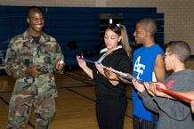 Cadet 1st Class Dwayne Lyons walks students through a team-building game during a Youth Diversity Outreach program visit Feb. 27. Photo by Bill Evans