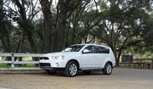 may030210-vis.jpg (end image) (set caption) The 2010 Mitsubishi Outlander was given a midlife touch-up that includes an aggressive facelift from the Lancer line and a more refined interior.
