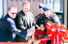 Gary Wilson, Actus Lend Lease senior construction manager; Pete Sims, Tierra Vista Communities, LLC, project director; Chief Master Sgt. Randy LaCombe, 50th Space Wing command chief; Col. Wayne Monteith, 50th SW commander; and Antonio Meneses, son of Tech. Sgt. Rafael Meneses, 50th Space Communications Squadron. (U.S. Air Force photo/David Ahlschwede)