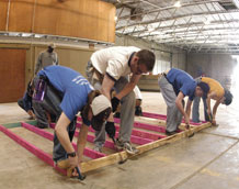 Cadets 3rd Class Kirby Forssell and Chris Miller, Cadet 1st Class Michael Bates and Cadet 3rd Class Paola Gavilanes assemble a wall frame in Bryan, Texas, March 23.