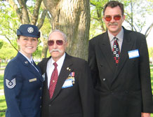 Tech. Sgt. Candi Fernandez, National Reconnaissance Office Operations Squadron, takes a photo with her grandfather, retired Army Master Sgt. Robert Sloate and her uncle, Charles Sloate, at a wreath laying ceremony to commemorate the Korean War April 12. Robert Sloate was recognized as a war hero for saving a Korean soldier's life and returning a flag, which the wounded soldier gave him 57 years ago, to the Korean Embassy. (Courtesy photo)