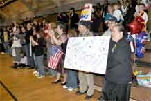 Friends and Family smile and cheer as the Soldiers from the 71st Ordnance Group (Explosive Ordnance Disposal) enter the Special Events Center.