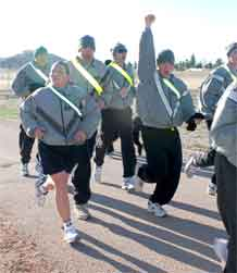 Fort Carson Soldiers cross the finish line of the five-kilometer Sexual Assault Awareness Run, at Ironhorse Park April 8.