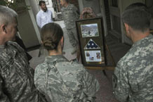 In ceremonies at Camp Eggers and Sia Sang in Kabul Thursday, buildings were dedicated to Air Force 1st Lt. Roslyn Shulte and Shawn Pine, two NATO Training Mission-Afghanistan members who were killed by an IED one year ago. Photo by Air Force Staff Sgt. Rachel Martinez