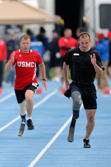 Marine and Army athletes push themselves during a Warrior Games track and field event at the Academy May 14.  Photo by Bill Evans