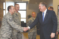 Master Sgt. Jason Hodson, 76th Space Control Squadron, greets Michael Donley, secretary of the Air Force, April 13, at Building 2028, the new 76th SPCS facility on Peterson AFB. Secretary Donley presented the 21st Operations Group with the Meritorious Unit Award for meritorious conduct in direct support of combat operations from June 2, 2007 to July 7, 2009. (U.S. Air Force photo/Rob Bussard)