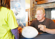 Six-time pro bowler and former Denver Broncos linebacker Karl Mecklenburg signs autographs following a tour of Schriever Air Force Base June 4 at the base housing area community center. (U.S. Air Force photo/Staff. Sgt. Daniel Martinez)