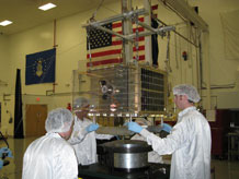 Cadets prepare for thermal and vibration testing at Kirtland Air Force Base, N. M., on the engineering model of FalconSAT-5. Courtesy Photo