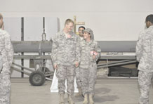 Senior Airman Donald Nolen and Senior Airman Sheri Nolen walk down the aisle as husband and wife after their wedding ceremony Aug 4, 2010, at an air base in Southwest Asia. The Nolens are members of the 380th Expeditionary Aircraft Maintenance Squadron. They were married by proxy on July 12, 2010, through the state of Montana. (U.S. Air Force photo/Tech. Sgt April Wickes)