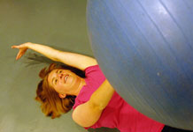 "Capt. Colleen Noonan, 3rd Space Operations Squadron, performs an exercise known as ""dead bug"" while training at the fitness center. After working with personal trainer Patti Eafrati, Captain Noonan scored five points higher on her Air Force Fitness Assessment, dropped 15 pounds and 3.5 inches off her waist. U.S. Air Force photo/Scott Prater"