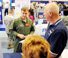 Capt. Brian Roettele, 3rd Space Operations Squadron, gets more information from a local Pikes Peak Region non-profit organization during the Schriever Combined Federal Campaign kick off event Sept. 30. More than 30 local organizations were on hand to answers questions and provide information concerning their organizations. This is the third year Schriever has used the open house as a kick off event. (U.S. Air Force Photo/Dennis Rogers)