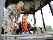 Tech. Sgt. Jeffrey Brown, 50th Civil Engineering Squadron, explains the workings of a piece of heavy equipment to 8 year old Kaden Jones, son of Tech. Sgt. Bernadette Jones, 50th Space Communications Squadron. Sergeant Brown and the rest of the 14-member snow removal team use this piece of equipment as well as other large pieces of equipment for snow removal. (U.S. Air Force Photo/Dennis Rogers)