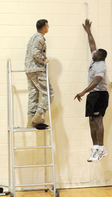 Capt. Terence Staples, Headquarters and Headquarters Troop, 2nd Special Troops Battalion, 2nd Brigade Combat Team, 4th Infantry Division, performs a vertical jump during Nov. 5 at Waller Physical Fitness Center.