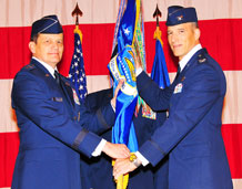 "Maj. Gen. Frank J. Padilla, 10th Air Force commander, left, hands the 310th Space Wing flag and command of the Air Force Reserve's only space wing to Colonel Jeffrey ""Sal"" Mineo. Colonel Mineo became the third commander of the 310th Space Wing during the Jan. 9 ceremony hosted by its sister wing, the 302nd Airlilft Wing at Peterson Air Force Base, Colo. (U.S. Air Force photo/Tech. Sgt. Nick Ontiveros)"