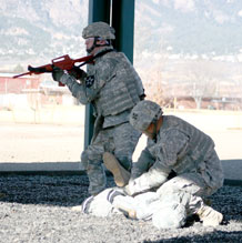 Photo by Staff Sgt. Wayne Barnett.  Members of the Fort Carson Modern Army Combatives Team demonstrate how to detain an enemy combatant during an escalation of force scenario demonstration at Wednesday's ribbon-cutting ceremony.