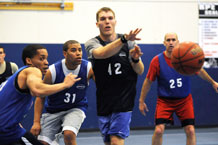 Aaron Kirchoff, 50th Comptroller Squadron/Force Support Squadron, passes to a teammate as Wade McGrew and Willie Jenkins defend for 1st Space Operations Squadron during the Schriever intramural basketball championship game here March 22. (U.S. Air Force photo/Dennis Rodgers)