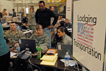 Staff Sgt. John Sweeney, Master Sgt. Brenda Pyle and Airman 1st Class Lisa Klevenberg, 21st Logistics Readiness Squadron, help process more than 550 military family members voluntarily leaving Japan after the March 11 earthquake there. A hangar near Denver International Airport was used as a processing area for the military families returning from Japan. Servicemembers from all branches came together to help provide support for the military families returning home from Japan. (U.S. Air Force photo/Airman 1st Class Jessica Hines)