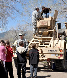 Students learn about the Husky Vehicle Mounted Mine Detector MKIII armored vehicle from 4th Engineer Battalion Soldiers.
