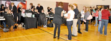 Military Spouse Appreciation Day attendees wait in line for free haircuts May 12 at the Armed Services YMCA.