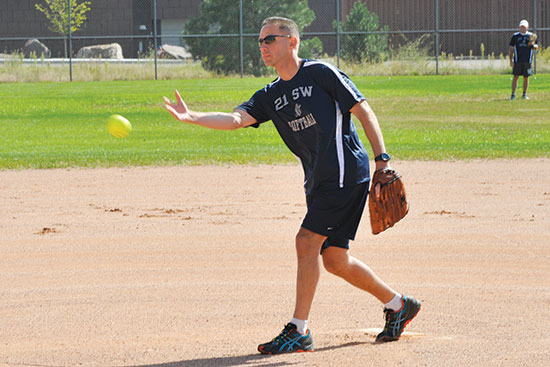 (U.S. Air Force photo/Robb Lingley) PETERSON AIR FORCE BASE, Colo. — Chief Master Sgt. Rich Redman, 21st Space Wing command chief, delivers another strike during the Space World Series Sept. 20. The 21st Space Wing Chiefs and Eagles softball team competed against the 50th Space Wing Chiefs and Eagles softball team. Redman earned a win as Team 2-1 defeated Team 5-0 by a score of 21-15.