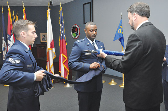 (Courtesy photo)  NAVAL SUPPORT FACILITY DAHLGREN, Va. — Capt. Roland Rainey, commander, 614th Air and Space Operations Center, Det. 1, performs a flag casing ceremony during the Air Force Space Surveillance System and 20th Space Control Squadron, Det. 1 closing ceremony Oct. 1. Roland was assisted in the ceremony by current 20th SPCS, Det. 1 members including Kenneth St. Clair, Senior Airman Nicholas Mikelis, and Tech. Sgt. John McIntyre (not pictured). The 20th SPCS, Det. 1 manpower and resources have been realigned under the 614th AOC, Det. 1.