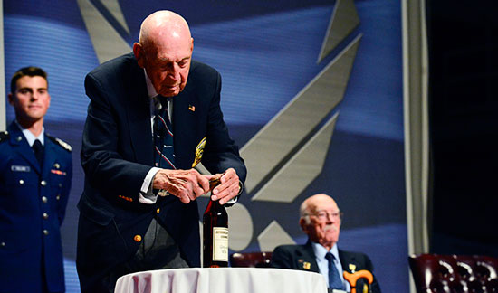 "(U.S. Air Force photo/Desiree N. Palacios) Retired Lt. Col. Richard ""Dick"" E. Cole opens the 1896 bottle of cognac before The Doolittle Tokyo Raiders shared their last and final toast at the National Museum of the U.S. Air Force Nov. 09, 2013 in Dayton, Ohio. Cole was the copilot of Aircraft No. 1."