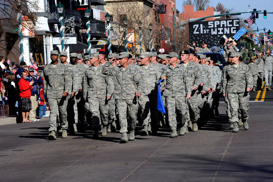 (U.S. Air Force photo/Robb Lingley)  COLORADO SPRINGS, Colo. — Col. John Shaw, 21st Space Wing commander, leads a flight of 21st SW Airmen in the Colorado Springs Veterans Day parade Nov. 9. The annual parade honors those who have served and are still serving, and draws a crowd of thousands.