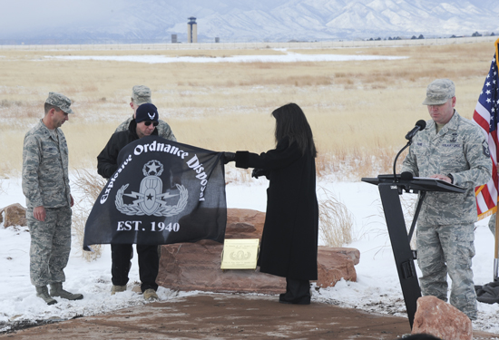 (U.S. Air Force photo/Staff Sgt. Jacob Morgan)  PETERSON AIR FORCE BASE, Colo. – Marc and Lauren Seidler, Airman 1st Class Matthew Seidler's parents, remove an explosive ordnance disposal banner unveiling a memorial in their son's honor Jan. 5. Matthew Seidler was killed by an improvised explosive device Jan. 5, 2012, while deployed to Helmand province, Afghanistan, performing route clearance while attached to an Army platoon.