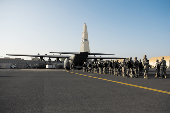 (U.S. Air Force Tech. Sgt. Micah Theurich/Released) Soldiers of the East Africa Response Force load onto a U.S. Air Force C-130 Hercules at Camp Lemonnier, Djibouti, to support an ordered departure in Juba, South Sudan Dec. 18, 2013. At the request of the U.S. Department of State, the U.S. Defense Department directed U.S. C-130 aircraft, one from the Air Force Reserve Command's 302nd Airlift Wing, to move personnel from Juba, the capital of South Sudan, to Nairobi, Kenya.