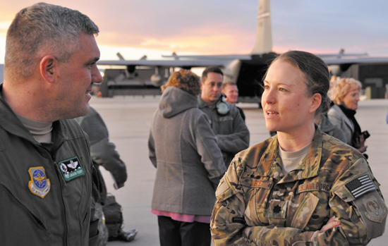 (U.S. Air Force photo//Master Sgt. Daniel Butterfield) Lt. Col. Joey Dible, right is greeted by 52nd Airlift Squadron Commander Lt. Col. Jason Terry upon her return to Peterson Air Force Base, Colo. on Jan. 15, 2014. Dible served as the 52nd Expeditionary Airlift Squadron Commander leading approximately 30 Airmen and the squadron's C-130 airlift missions in support of Combined Joint Task Force-Horn of Africa, based at Camp Lemonnier in Djibouti, Africa. Dible, a C-130 master navigator and the director of staff is assigned to the Peterson-based 52nd Airlift Squadron.