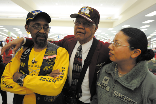 (U.S. Air Force photo/Staff Sgt. Aaron Breeden) PETERSON AIR FORCE BASE, Colo. — Staff Sgt. Marcela Parker (right), receives an impromptu history lesson from Jay Lamb (left), secretary of the Colorado Springs Buffalo Soldiers chapter, and retired Chief Master Sgt. Loran Smith (center), second-generation Tuskegee Airman, during a Black History Month event at the Base Exchange Feb. 14. The event featured members from the local Buffalo Soldiers chapter, the local Tuskegee Airman chapter, and also Navajo Code Talkers, all of whom shared detailed recounts of their service to eager patrons that day.