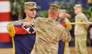 Photo by Sgt. Nelson Robles.  Lt. Col. Daniel K. Kirk, deputy commanding officer, and Sgt. Maj. Danny L. Day, senior enlisted adviser, 4th Infantry Brigade Combat Team, 4th Infantry Division, case their brigade colors, Wednesday.