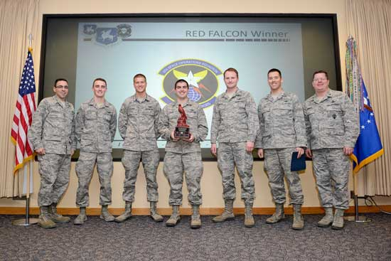 The 4th Space Operations Squadron Alpha Crew members receive the RED FALCON trophy during an award ceremony March 13, 2014, at Schriever Air Force Base, Colo. RED FALCON was designed to inspire 50th Space Wing crews to develop system expertise that exceeds surface checklist knowledge, foster the normalization of non-routine mission protection procedures and identify the 50th Operations Group crew best prepared to operate in ill-defined emergency situations.