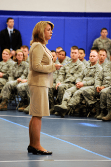 U.S. Air Force Photo/Dennis Rogers Secretary of the Air Force Deborah Lee James addresses Team Schriever at the base fitness center during her visit March 6, 2014. James received a mission briefing and observed several of the wing's operations first hand.
