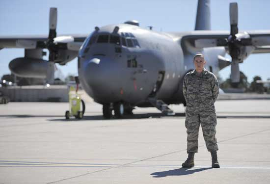 (U.S. Air Force photo/Staff Sgt. Jacob Morgan)  PETERSON AIR FORCE BASE, Colo. – Staff Sgt. Madeline Whiton, 21st Logistics Readiness Squadron materials management technician, stands in front of a C-130 assigned to the Air Force Reserve Command's 302nd Airlift Wing March 11. Whiton works in the flight service center where she provides supply needs for all C-130 aircraft maintenance squadrons here.