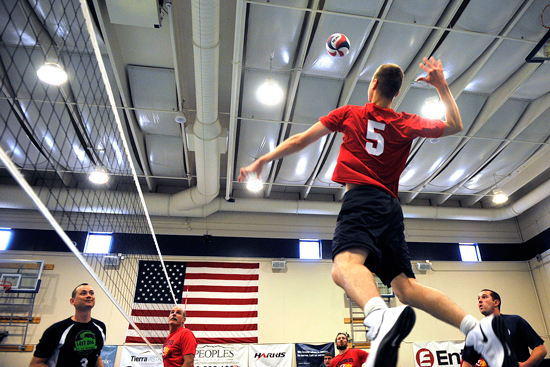 U.S. Air Force photo/Dennis Rogers Schriever's Jonathan Plyler prepares to spike the ball during a preliminary match against Buckley during the 2014 Rocky Mountain Regional Volleyball Tournament May 17, 2014, at Schriever Air Force Base, Colo. The Schriever Fitness Center hosted the tournament.