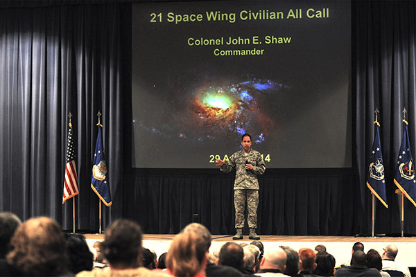 (U.S. Air Force photo/Staff Sgt. Jacob Morgan) PETERSON AIR FORCE BASE, Colo. — Col. John Shaw, 21st Space Wing commander, addresses an audience of more than 400 in-person and 300 virtual attendees at a civilian all-call April 29. The topics included opportunities and ideas for efficient operations, civilian and military force management programs, marijuana legalization impacts, civilian leave, his command philosophy and upcoming base events.