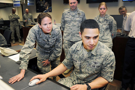 U.S. Air Force photo Maj. Shanna Corbet, 19th Space Operations Squadron, reviews procedures with Airman 1st Class Alan Faeldan, 2nd Space Operations Squadron, during the Civil Navigation implementation April 28, 2014, at Schriever Air Force Base, Colo. The initiative will allow Air Force Space Command to broadcast Civil Navigation messages on all operational GPS satellites capable of transmitting L2C and L5 signals.