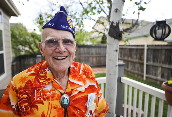 (Courtesy photo) COLORADO SPRINGS, Colo. – Wayne Field stands in his backyard here May 28, 2014, wearing his Military Order of the Purple Heart Association flight cap. Field was a mechanized reconnaissance veteran who fought in the Battle of the Bulge and was wounded shortly after in 1945. After being discharged from the Army, Field started the first post-World War II Civil Air Patrol units in Binghamton, New York, and served in the CAP for more than 30 years contributing to the success of CAP today. Field received the Congressional Gold Medal, the highest civilian award for his service during World War II as a member of the CAP. He joins a prestigious list of recipients ranging from George Washington to Gandhi.