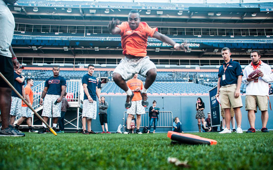 U.S. Air Force photo/Staff Sgt. Julius Delos Reyes Jevon Butler, 50th Space Communications Squadron, participates in the broad jump as part of the USAA-Broncos Military Combine Saturday at Sports Authority Field in Denver. Service members who participated in the combine also received an opportunity to meet with Denver Broncos players such as Wes Welker and Demarcus Ware.